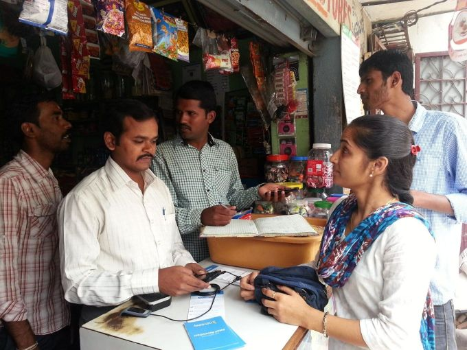 A Merchant with Point of Sales Device